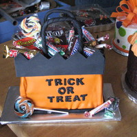 Treat Or Treat Bag Trick or Treat Bag filled with candy. I did these two cakes for the school and church cake walks. Both cakes were covered in marshmellow...