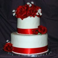 "Red Rose 10"" inch and 6""round cherry cake with buttercream filling withmmf and silk roses. ribbon trim....someone please give me some tips..."