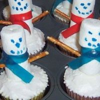 Snowmen Cupcakes I made these for an auction at my mother in laws work. I used buttercream iceing 2 marshmellows skewered on a pretzel stick, fruit roll ups...
