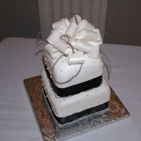 Black And Silver Wedding For a wedding today, chocolate cake, buttercream frosting with fondant beads, satin ribbon and gumpaste bow (my first ever). I decided that...