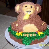 "Monkey Birthday Cake This was made using the Wilton 3-D Bear pan on a 10"" round. The bear and base are frosted with buttercream with fondant accents. I..."