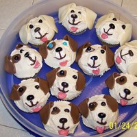 Doggie Cupcakes   Made to look like a Jack Russell Terrier and a Golden Lab.