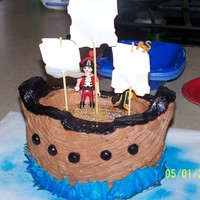 Pirate Ship Cake  For my nephew's 4th birthday. I used the oval pans that you get for one of the Wilton classes, then carved them a bit to shape the...