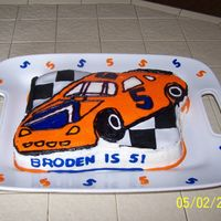 Hot Wheels Cake  Used the racecar checkered flag pan for this cake. The car was done using FBCT. I was not at all happy with my buttercream (tried using...