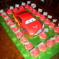 Lightning Mcqueen! Birthday cake for little boy, framed with cupcakes to match :)