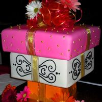 Upside Down Cake Boxes... Customer wanted an upside down cake which looked like wrapped presents...