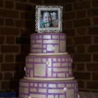Homage To Linoleum This cake was inspired from the book Cakewalk. the cakes are painted in silver lusterdust and the pattern is painted in lilac. The frame on...