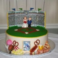 Baseball Stadium Sorry-the other picture was too small! Everything was modeled out of fondant-my first time modeling, ever!!!! The food aroudn the base of...