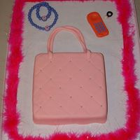 Purse Cake My first purse cake which I attempted to copy from thecakemaker here on CC.Believe it or not but this cake is for a 3 year olds birthday...