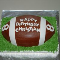 Football1.jpg Football sourcream poundcake with chocolate buttercream frosting, mmf accents. 1/4 sheetcake sourcream poundcake buttercream icing. Thanks...