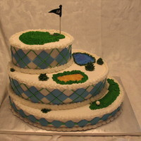 Golf Course Cake Oval, three tiered cake with fairway, water and sand trap and the green on top! Buttercream with fondant accents. Flavors are lemon with...