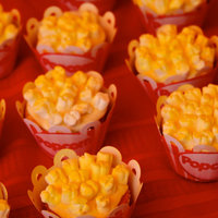 Popcorn Marshmallow Cupcakes Vanilla cupcakes with homemade vanilla butter cream topped with marshmallows and sprayed with yellow frosting spray to look like buttered...