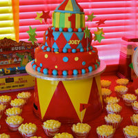 Circus Extravaganza! Circus themed cake for a little boys first bday. The Mom sent me a picture of what she wanted. It is 3 tiers of cake and the big top tent...