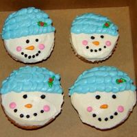Frosty The Snow People Different sized cupcakes made the snowmen like like a snow family. All BC