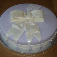 Miriam 10 inch cake covered in fondant with fondant ribbon/bow/tag/flowers