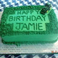 John Deere  The cake is supposed to look like the JD lawn mower clipped the grass leaving the Happy Birthday message. JD doesn't make a replica...