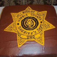 Augustin Groom Cake Pattern transfer of sheriff's badge. choc w/ choc frosting.