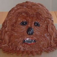 Chewbacca   This severred head is not my most favorite cake that I have done, but my family loves it so I'm posting it. Pretty weird, huh!