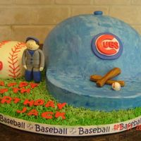 Chicago Cubs Cake Marble Cake, Chocolate Buttercream. Blue Buttercream Icing, Logos and figures done in gumpaste.