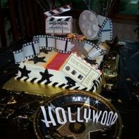 Hollywood Birthday Cake  My friend Bev came over and helped me come up with a cake any kid would want for a Hollywood theme party. My daughters friends were all...
