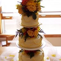Fall Wedding Made for a small backyard reception. Yellow buttercream, with fresh fall flowers. Thanks for looking.