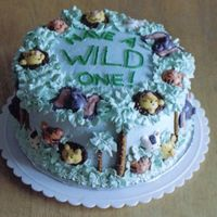 Have A Wild One!!  buttercream Jungle theme cake, with candy animals, pretzel palm trees. This cake was time consuming, but seeing the kids at the party made...