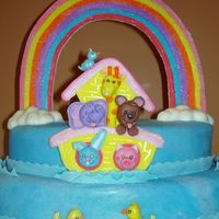 Noah's Arc Fondant coverd cake with fondant/gumtest rainbow, fondant/gumtext animals and fondant clouds.