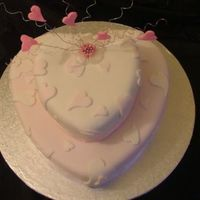 "Sweet Heart Birthday Cake two tier <10"" and 6""> heart shaped cake. WHite cake with black cherry filling.Bottom tier Pink with white ribbon..."