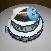 My Younger Son's Bar Mitzvah Cake Strawberry cake w/Banana Filling, Banana cake w/Strawberry Filling, and a Chocolate Football on Top
