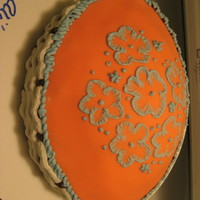 Apricot Basketweave With 'embroidery' Work  This oval-shaped apricot colored cake features basketweave and my first attempts at doing 'brush embroidery' - thanks for looking...