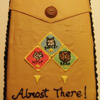 Cub Scout Uniform Cake  This cake was made for a Cake Raffle by our local Cub Scout Pack. It depicts three of the four badges of rank as you progress through the...