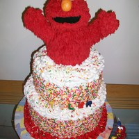 Elmo This is a cake i made for my grandson's 1st birthday. Bottom cake is chocolate with buttercream filling. Top is carrot cake with cream...