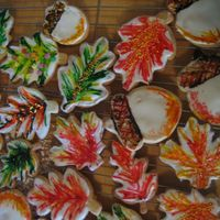 Autumn Cookies, Acorns And Leaves!  aww...so pretty - white royal icing with toothpicked wilton gel hand painted on ... some are then further adorned with sprinkles or glitter...