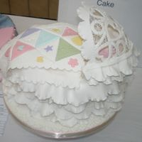 Baby Cradle Cake Baby cradle has a patchwork quilt and a battenburg lace hood.
