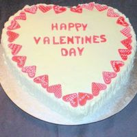 "14"" Valentines Cake Vanilla cake with meringue buttercream. A fun cake I made for our Seniors group. Some of the fondant hearts have sayings from those little..."