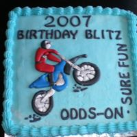 Motorcross French vanilla buttercream. Colourflow motorbike. Cake was for a joint birthday celebration for all the family.