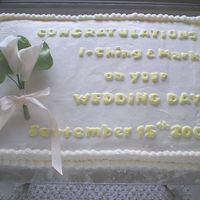2 Of 2 Church Reception Cakes White gumpaste calla lilies, colourflow letters