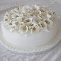 Calla Lilies This was one of two fondant covered cakes for a garden wedding. The calla liles were made from a mixture of fondant and gum trag. It's...