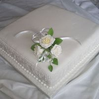 White Roses Can't remember why there wasn't a message on this cake. The dot detail on the sides was very time consuming, but I think it was...