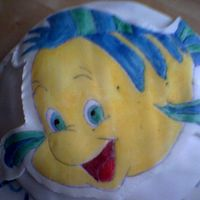 Flounder Cake Made this cake for my boyfriend a couple of years ago. Very simple but i thought it turned out quite well.I used fondant icing and painted...