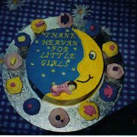Baby Girl THE BABY ON THE CAKE IS MADE OF CHOCOLATE AND THE CUPCAKES ALL HAVE CHOCOLATE BABY DECORATIONS I.E BOOTS, BOTTLES ECT.