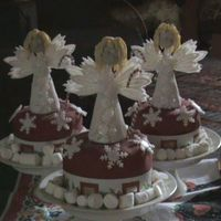 Snowflake Angels I made these miniature cakes for my little boys teachers for christmas. They are slightly bigger than cupcakes and i found these cute...