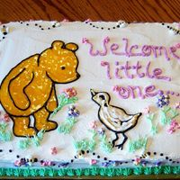 Classic Winnie The Pooh White almond sourcream cake with buttercream and gel decorations.