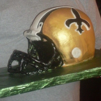 Who Dat! This was my first attempt at a helmet cake for my uncle's 60th birthday. I cheated because it was last minute so the the faceguard is...