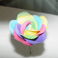 Rainbow Rose I've seen pictures on other sites of real roses dyed to look like a rainbow so I wanted to try it in gumpaste, and I think it turned...