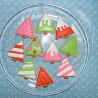 Mod Christmas Trees Whew! This was my first time decorating cookies. I followed antonia74's sugar cookie how-to, but obviously they're nowhere near...