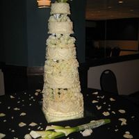 New Years Eve Wedding Cake 5 Tiered Carrot cake with pecan praline filling and cream cheese butter cream decoration. Over 200 roses between the layers!