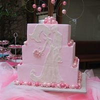 Pink Silhouette  The silhouette was piped in royal on the flush back of the square cakes. All the baubles are fondant or pearls shimmered up with lots of...