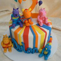 Backyardigans iced in buttercream with lots of fondant accents. Backyardigans made from fondant and gumpaste.