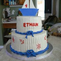 Sail Boat two tiered sail boat cake with nautical symbols. Buttercream icing with fondant decorations.